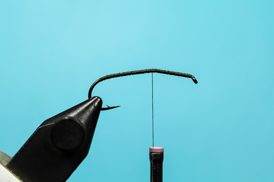 1. Bend the hook and prepare the with thread