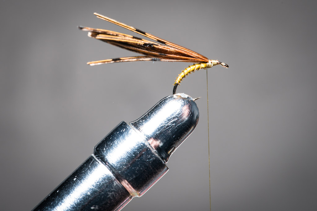 5. Secure the pheasant tail at 5 mm from the hook eye