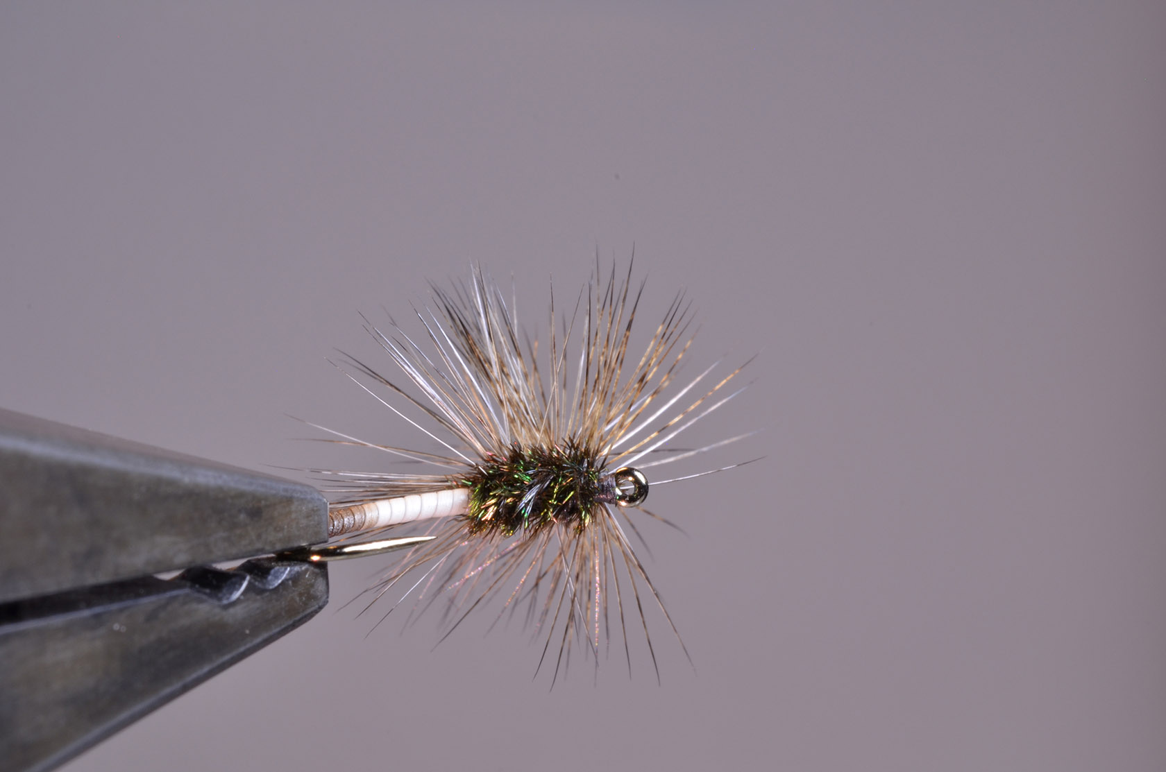 15. Dense, speckled hackle that to me suggests motion (Emerger).