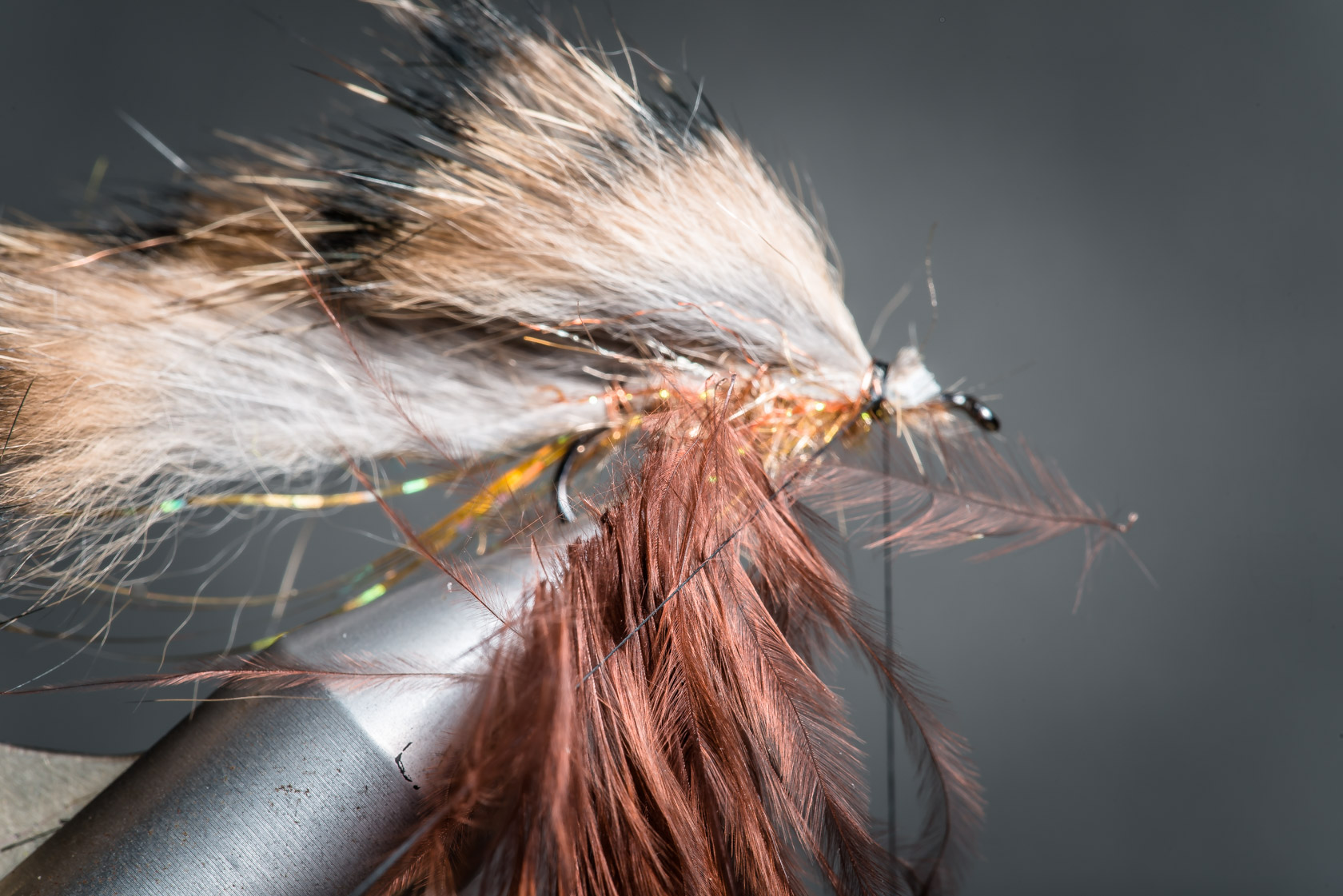 9. Set a third of a brown marabout feather in a dubbing loop